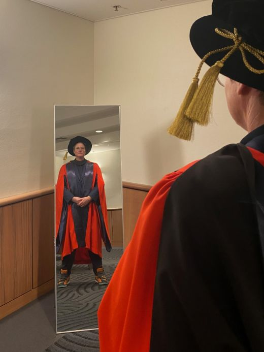 Hannah Gadsby in ceremonial robes