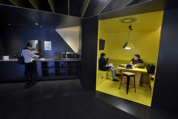 Students in contemporary student area. Black, yellow and orange colour scheme.