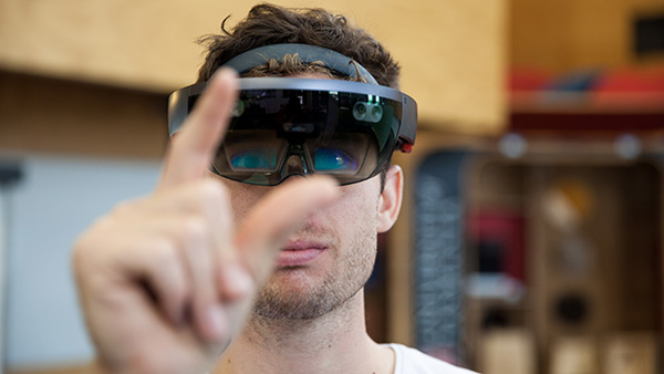 Headshot of Jackson Wells using VR headset
