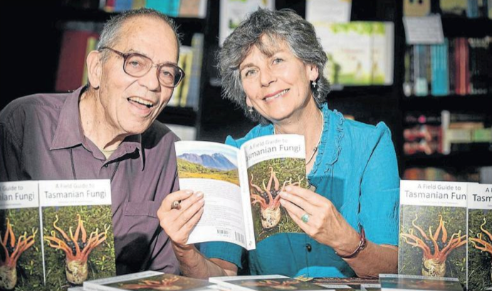 Drs Genevieve Gates and David Ratkowsky reading their book 'A Field Guide to Tasmanian Fungi'