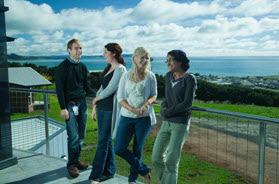 Students enjoying a break on the balcony of RCS