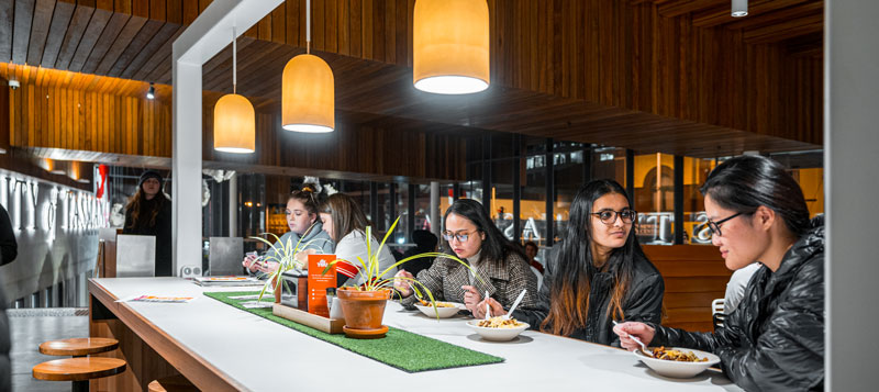Students eating in a communal area