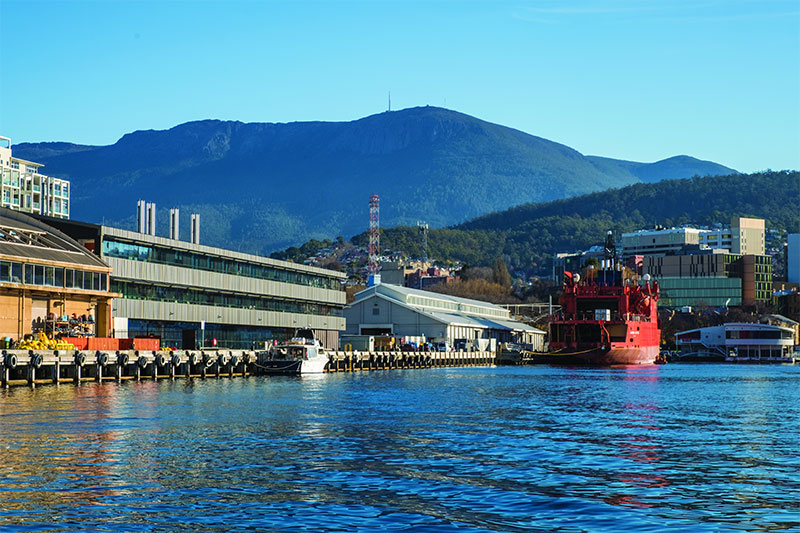 Waterfront view of the IMAS building with Aurora Australis vessel.
