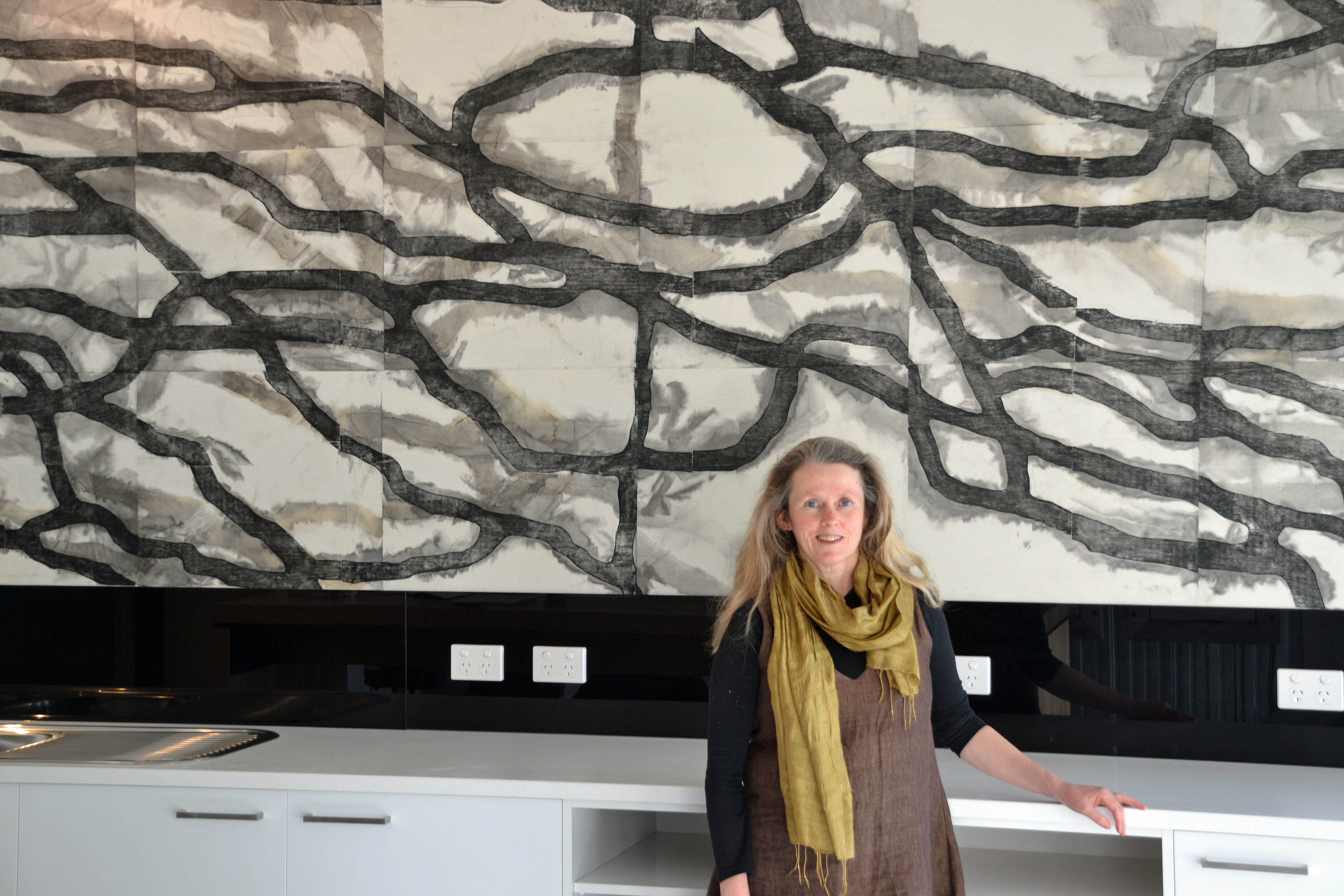 Academic leader's work features in apartment build