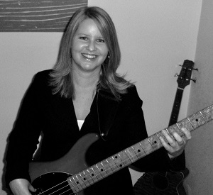 Rochelle with electric bass guitar