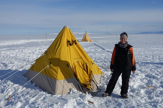 Assoc Prof Leane next to her tent